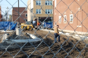 Laborers working construction site at 7 a.m.