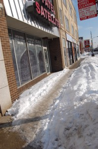 Closed business. Building for sale. Who's supposed to shovel?