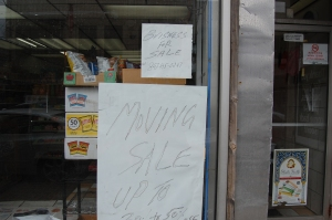 Signs of the times: Business for Sale and Moving Sale.