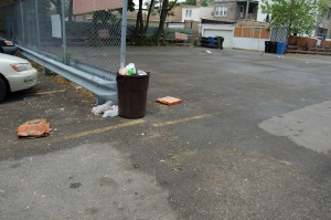 Garbage in parking lot and E-W alley between Campbell and Artesian.