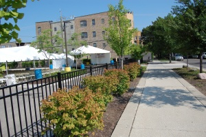 Completed audience and soundstage set-up for 2015 India Day celebration in Republic Bank parking lot. Note that soundstage is directly in front of residential housing, separated only by an alley.